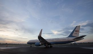In this Aug. 14, 2015, file photo, the airplane carrying U.S. Secretary of State John Kerry prepares to depart the airport in Havana, Cuba, after the reopening of the U.S. Embassy after 54 years of broken diplomatic relations. (AP Photo/Ismael Francisco, Cubadebate, File)