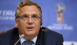FILE - In this Friday, July 24, 2015 file photo, FIFA Secretary General Jerome Valcke attends a press conference near Constantine (Konstantinovsky) Palace in St. Petersburg, Russia, on the eve of the Preliminary draw for the 2018 World Cup in Russia. FIFA ethics committee bans former secretary general Jerome Valcke for 12 years, Friday Feb. 12, 2016. (AP Photo/Dmitry Lovetsky, File)