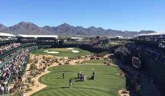 In this Saturday, Feb. 5, 2016, photo, golfers and caddies gather on the 16th green during the third round of the  Phoenix Open golf tournament at TPC Scottsdale in Scottsdale, Ariz. A picturesque par-3 for 51 weeks, No. 16 at TPC Scottsdale transforms into a golf version of a party cruise the week of PGA Tour's annual stop in the Valley of Sun. (AP Photo/John Marshall)