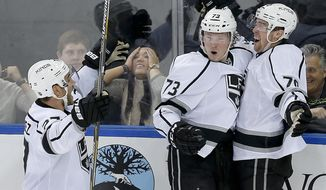 Los Angeles Kings left wing Tanner Pearson (70) celebrates with center Tyler Toffoli (73) and defenseman Alec Martinez (27) after scoring the game-winning goal against the New York Rangers in overtime of an NHL hockey game, Friday, Feb. 12, 2016, in New York. The Kings won 5-4. (AP Photo/Julie Jacobson)