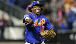 FILE - In this Wednesday, Sept. 10, 2014, file photo, New York Mets relief pitcher Jenrry Mejia tosses the ball to throw out Colorado Rockies' Josh Rutledge at first base to end a baseball game in New York. Mejia became the first player to receive a lifetime ban under baseball's drug agreement testing positive for a performance-enhancing substance for the third time. Mejia tested positive for Boldenone, the commissioner's office said Friday, Feb. 12, 2016. (AP Photo/Frank Franklin II, File)