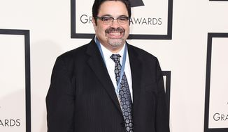 """FILE - In this Feb. 8, 2015 file photo, Arturo O'Farrill arrives at the 57th annual Grammy Awards in Los Angeles.  O'Farrill is nominated for two Grammys, one for large jazz ensemble album for """"Cuba:The Conversation Continues,"""" and best instrumental composition for """"The Afro Latin Jazz Suite."""" (Photo by Jordan Strauss/Invision/AP, File)"""