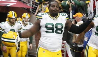 FILE - In this Dec. 27, 2015, file photo, Green Bay Packers nose tackle Letroy Guion (98) gestures during an NFL football game against the Arizona Cardinals, in Glendale, Ariz. The Green Bay Packers have re-signed defensive tackle Letroy Guion, a move that could impact the return of fellow lineman B.J. Raji. General manager Ted Thompson announced the signing on Friday, Feb. 12, 2016. (AP Photo/Rick Scuteri, File)