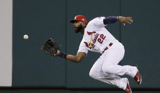 FILE - In this Oct. 9, 2015, file photo, St. Louis Cardinals right fielder Jason Heyward prepares to catch a ball hit by Chicago Cubs' Addison Russell during the third inning of Game 1 in baseball's National League Division Series in St. Louis. Heyward is among the top players to join the NL Central. (AP Photo/Jeff Roberson, File)
