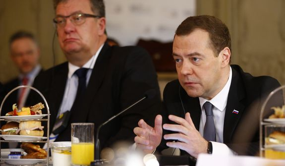 Russian Prime Minister Dmitry Medvedev, right, attends a breakfast with members of a German Economic delegation at the Security Conference in Munich, Germany, Saturday, Feb. 13, 2016. (AP Photo/Matthias Schrader)