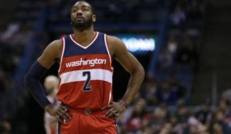 Washington Wizards' John Wall during an NBA basketball game against the Milwaukee Bucks Thursday, Feb. 11, 2016, in Milwaukee. (AP Photo/Aaron Gash)