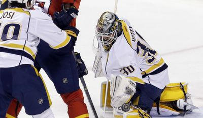 Nashville Predators goalie Carter Hutton (30) blocks a shot by Florida Panthers right wing Jaromir Jagr (68) during the second period of an NHL hockey game, Saturday, Feb. 13, 2016, in Sunrise, Fla. (AP Photo/Alan Diaz)