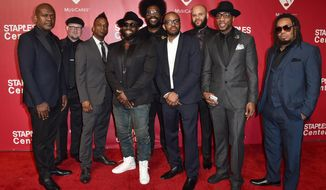 The Roots arrive at the MusiCares Person of the Year tribute honoring Lionel Richie at the Los Angeles Convention Center on Saturday, Feb. 13, 2016. (Photo by Jordan Strauss/Invision/AP)