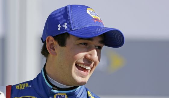 Chase Elliott laughs with crew members in Victory Lane after he qualified for the pole position in the NASCAR Daytona 500 auto race at Daytona International Speedway, Sunday, Feb. 14, 2016, in Daytona Beach, Fla. (AP Photo/John Raoux)
