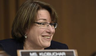 FILE - In this Jan. 28, 2015 file photo, Sen. Amy Klobuchar, D-Minn. is seen on Capitol Hill in Washington. Klobuchar is a possible pick by President Obama as a candidate to fill the Supreme Court seat of the late Justice Antonin Scalia. (AP Photo/Susan Walsh)