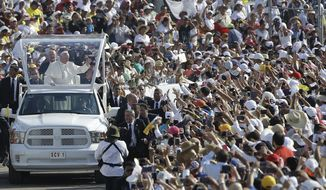 Pope Francis arrives in the popemobile to Viktor Manuel Reyna stadium, in Tuxtla Gutierrez, Mexico, Monday, Feb. 15, 2016. (AP Photo/Gregorio Borgia)