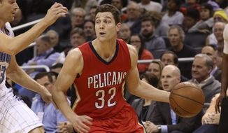 FILE - In this Feb. 20, 2015, file photo, New Orleans Pelicans guard Jimmer Fredette (32) controls the ball during the first half of an NBA basketball game against the Orlando Magic in Orlando, Fla. For Fredette and the NBA D-League All-Stars, hope that the big league will call springs eternal. (AP Photo/Reinhold Matay, File)
