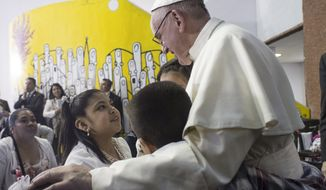 In this photo taken on Sunday, Feb. 14, 2016, Pope Francis meets children during his visit to the Federico Gomez Pediatric Hospital, in Mexico City. The pope makes a point of stopping at children's hospitals during his foreign trips, both to visit with the kids and to thank the staff for caring for them (L'Osservatore Romano/Pool Photo via AP)