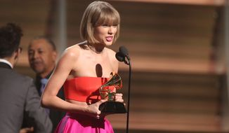 "Taylor Swift accepts the award for album of the year for ""1989"" at the 58th annual Grammy Awards on Monday in Los Angeles. (Associated Press)"