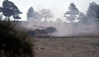 Turkish artillery fire from the border near Kilis toward northern Syria, in Kilis, Turkey, Monday, Feb. 15, 2016. Turkey defied international calls and shelled parts of northern Syria for a third day today, insisting it would not allow Kurdish-led forces to seize key areas along the border. The cross-border Turkish artillery fire, which began on Saturday, has added to an increasingly complex situation in Syria's northern Aleppo province just days before the cease fire is due to begin.(AP Photo/Halit Onur Sandal)