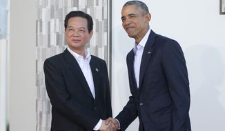 President Obama told Vietnamese Prime Minister Nguyen Tan Dung that he'll visit the communist-ruled country when he travels to Japan for the annual G-7 summit this spring. (Associated Press)