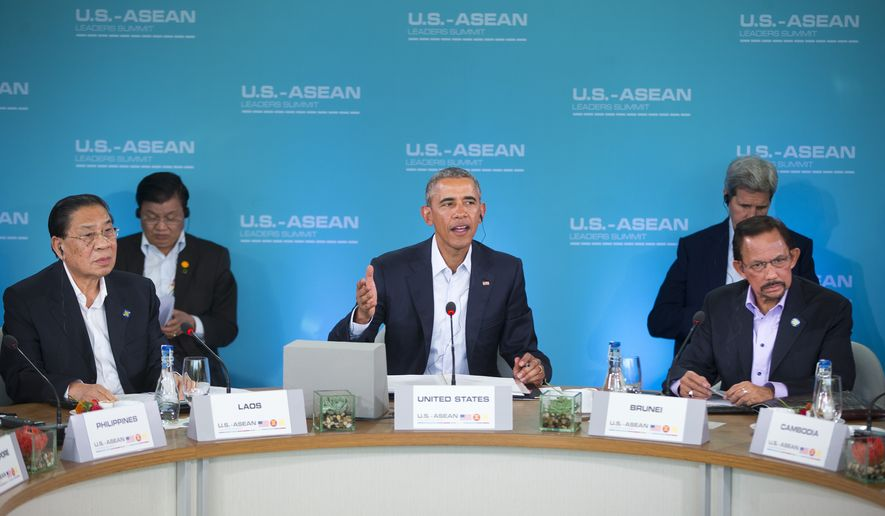 President Barack Obama, center, speaks at the plenary session meeting of ASEAN, the 10-nation Association of Southeast Asian Nations, at the Annenberg Retreat at Sunnylands in Rancho Mirage, Calif., for Monday, Feb. 15, 2016. President Obama is hosting the ASEAN leaders, it is the first meeting of its kind on U.S. soil, as he looks to deepen ties with the region's fast-growing economies. Sitting with Obama are Laos President Choummaly Sayasone, left, and Brunei's Sultan Hassanal Bolkiah, right. (AP Photo/Pablo Martinez Monsivais)