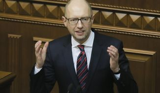 Ukrainian Prime Minister Arseniy Yatsenyuk speaks during an annual report in Parliament in Kiev, Ukraine, Tuesday, Feb.16, 2016. Ukraine's President Petro Poroshenko has called on the country's embattled prime minister to resign, a move that would break apart the fragile ruling coalition. (AP Photo/Efrem Lukatsky)