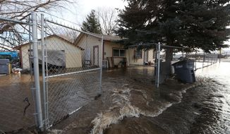 In this Monday, Feb. 15, 2016, photo, water floods a home in Tieton, Wash. A President's Day storm brought record rainfall to the Pacific Northwest and sent rivers overflowing their banks in Western Washington on Tuesday. (Sofia Jaramillo/Yakima Herald-Republic via AP) MANDATORY CREDIT