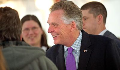 Virginia Gov. Terry McAuliffe speaks with members of the press Wednesday, Feb. 3, 2016, after he announced that EURO-COMPOSITES is investing to expand its U.S. operation in Culpeper County, Va. (Dave Ellis/The Free Lance-Star via AP) MANDATORY CREDIT