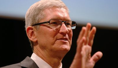 In this photo taken Nov. 15, 2015, Apple CEO Tim Cook speaks in Milan, Italy. A U.S. magistrate judge has ordered Apple to help the FBI break into a work-issued iPhone used by one of the two gunmen in the mass shooting in San Bernardino, California, a significant legal victory for the Justice Department in an ongoing policy battle between digital privacy and national security. Apple CEO Tim Cook immediately objected, setting the stage for a high-stakes legal fight between Silicon Valley and the federal government. (AP Photo/Luca Bruno)