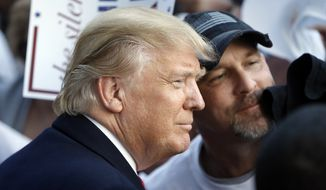 Republican presidential candidate Donald Trump meets with attendees during a campaign stop Wednesday, Feb. 17, 2016, in Walterboro, S.C. (AP Photo/Matt Rourke)