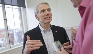 Sen. Rob Portman, R-Ohio, speaks to a reporter during the Queen City Mobile Summit at Union Hall, Wednesday, Feb. 17, 2016, in Cincinnati. (AP Photo/John Minchillo) ** FILE **