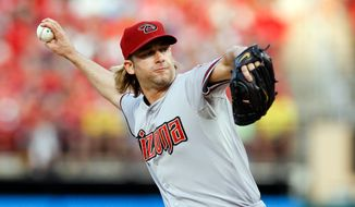 Arizona Diamondbacks starting pitcher Bronson Arroyo  throws during the first inning of a baseball game against the St. Louis Cardinals Tuesday, May 20, 2014, in St. Louis. (AP Photo/Scott Kane)