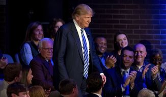 Republican presidential candidate Donald Trump arrives for a CNN town hall at the University of South Carolina in Columbia, South Carolina, on Thursday evening. (Associated Press)
