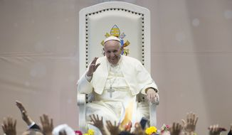 Pope Francis salutes faithful during his meeting with workers and advocacy groups in Ciudad Juarez, Mexico, Wednesday, Feb. 17, 2016.  Francis is on his way back to Italy after a five-day visit in Mexico. (L' Osservatore Romano/Pool photo via AP)