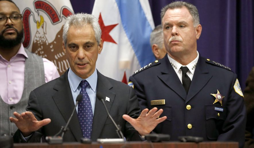 In this Nov. 24, 2015, file photo, Chicago Mayor Rahm Emanuel, left, and Police Superintendent Garry McCarthy appear at a news conference in Chicago, announcing first-degree murder charges against police officer Jason Van Dyke in the death of Laquan McDonald. Federal authorities confirmed on Feb. 4, 2017, that additional ATF agents are being deployed to the Windy City to combat the city's epidemic of gun-related crime. (AP Photo/Charles Rex Arbogast, File)