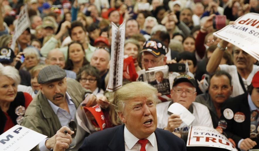 Republican presidential candidate Donald Trump speaks speaks with members of the media as he meets with attendees during a campaign stop, Friday, Feb. 19, 2016, in Myrtle Beach, S.C. (AP Photo/Matt Rourke)