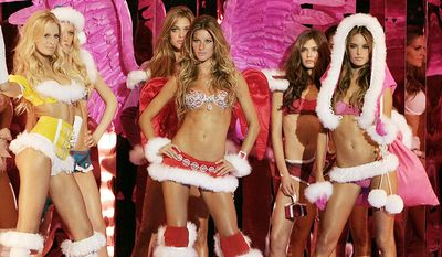 Gisele Bundchen, center, and other models pose in fur trimmed outfits at the start of the Victoria's Secret Fashion show, Wednesday, Nov. 9, 2005, in New York. The show is being broadcast Tuesday, Dec. 6, 2005, on CBS.   (AP Photo/Jeff Christensen)
