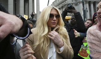 Pop star Kesha leaves Supreme court in New York, Friday, Feb. 19, 2016. (AP Photo/Mary Altaffer)