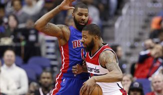 Washington Wizards forward Markieff Morris, right, drives against his twin brother, Detroit Pistons forward Marcus Morris, during the first half of an NBA basketball game Friday, Feb. 19, 2016, in Washington. (AP Photo/Alex Brandon)