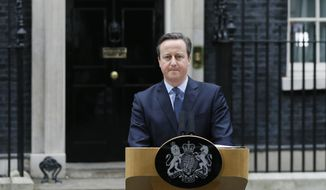 Britain's Prime Minister David Cameron delivers a statement in Downing Street in London, Saturday, Feb. 20, 2016. Cameron said Saturday a historic referendum on whether to stay in the European Union will be held on June 23. (AP Photo/Kirsty Wigglesworth)