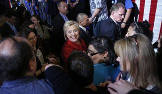 Democratic presidential candidate Hillary Clinton, center, meets with supporters during a Nevada Democratic caucus rally, Saturday, Feb. 20, 2016, in Las Vegas. (AP Photo/John Locher)