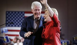 Democratic presidential candidate Hillary Clinton, right, waves on stage with her husband and former President Bill Clinton during a Nevada Democratic caucus rally, Saturday, Feb. 20, 2016, in Las Vegas. (AP Photo/John Locher)