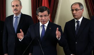 Turkish Prime Minister Ahmet Davutoglu, centre, flanked by his deputy Numan Kurtulmus, left, and Interior Minister Efkan Ala, speaks to the media after a security meeting in Ankara, Turkey, Saturday, Feb. 20, 2016.  Turkish authorities on Friday detained three more suspects in connection with the deadly bombing in Ankara that Turkey has blamed on Kurdish militants at home and in neighboring Syria, while Turkey's military pushed ahead with its cross-border artillery shelling campaign against U.S.-backed Syrian Kurdish militia positions in Syria.(AP Photo)