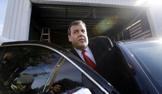 In this Feb. 6, 2016, file photo, Republican presidential candidate, New Jersey Gov. Chris Christie gets in his car after a campaign event in Bedford, N.H. (AP Photo/Elise Amendola, File)