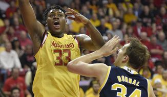 Maryland center Diamond Stone (33) goes to the basket against Michigan forward Mark Donnal (34) during the second half of an NCAA college basketball game, Sunday, Feb. 21, 2016, in College Park, Md. Maryland won 86-82. (AP Photo/Nick Wass)
