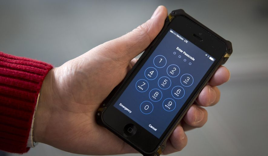 The San Bernardino County-owned iPhone at the center of an unfolding high-profile legal battle between Apple Inc. and the U.S. government lacked a device management feature bought by the county that, if installed, would have allowed investigators easy and immediate access. (Associated Press)