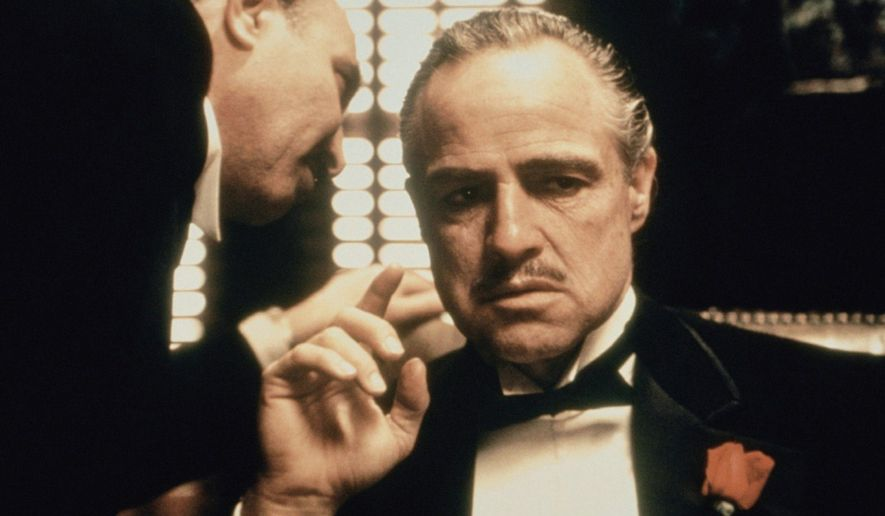 """Morally ambiguous strongmen, such as those portrayed by Marlon Brando and Salvatore Corsitto in """"The Godfather"""" movies seem to strike a chord among men with presidential ambitions, including Chris Christie and Mike Huckabee. (Paramount Pictures)"""