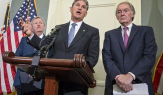 """Sen. Joe Manchin, D-W. Va., center, accompanied by Sen. Edward J. Markey, D-Mass., right, and Rodney Miller of the West Virginia Sheriffs' Association, talks about the problem of over-prescribed and under-regulated opioid pain medicines and their opposition to the nomination of Dr. Robert Califf to run the Food and Drug Administration, Monday, Feb. 22, 2016, during a news conference on Capitol Hill in Washington. While calling Dr. Califf """"a good man,"""" Manchin said Califf has too many ties to the pharmaceutical industry to properly deal with the prescription opioid abuse crisis in this country. (AP Photo/J. Scott Applewhite)"""