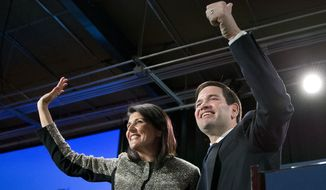 Sen. Marco Rubio, Florida Republican and 2016 presidential candidate, and South Carolina Gov. Nikki Haley wave to the crowd after speaking an election-night rally in Columbia, S.C., on Feb. 20, 2016. (Associated Press) **FILE**