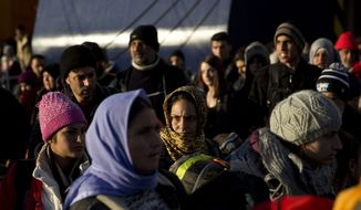 Migrants and refugees disembark from a ferry after their arrival along with hundreds of others at the port of Piraeus near Athens, on Monday, Feb. 22, 2016. Several thousand migrants have been stranded at the port and at the country's border with Macedonia, where authorities at the weekend closed the border to Afghan migrants and reduced rate for crossings for Iraqis and Syrians. (AP Photo/Petros Giannakouris)