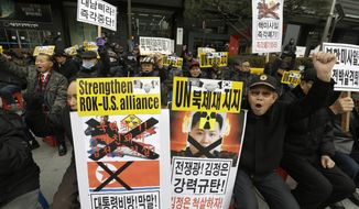 "Protesters hold placards with defaced images of North Korean leader Kim Jong Un while shouting slogans during a rally in Seoul, South Korea, Monday, Feb. 22, 2016. North Korea responded to an unusually harsh verbal attack by South Korean President Park Geun-hye against the North's leader and its recent nuclear test and rocket launch with a characteristically colorful invective of its own Saturday, calling her policy traitorous and adding that Washington's newly enacted sanctions are ""laughable."" The placards read: ""Denounce Kim Jong Un."" (AP Photo/Ahn Young-joon)"