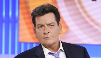 "In this Tuesday, Nov. 17, 2015, file photo, actor Charlie Sheen appears during an interview on NBC's ""Today"" show in New York, saying he tested positive four years ago for the virus that causes AIDS. A new study released Monday, Feb. 22, 2016, found that Sheen's revelation prompted the greatest number of HIV-related Google searches recorded in the United States since 2004. (Peter Kramer/NBC via AP)"
