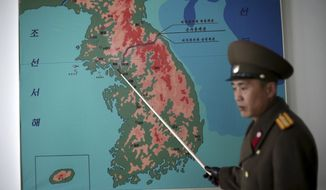 """North Korean People's Army Lt. Col. Nam Dong Ho told The Associated Press this year that tensions increased significantly along the Demilitarized Zone since North Korea conducted its nuclear test and rocket launch. He said he could not comment on operational details, but added, """"The reality is that it is touch and go."""" (Associated Press/File)"""