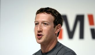 Facebook CEO Mark Zuckerberg speaks during a conference at the Mobile World Congress, the world's largest mobile phone trade show in Barcelona, Spain, in this March 2, 2015, file photo. (AP Photo/Manu Fernandez, File)